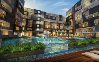 What are the main advantages of buying an apartment in Phuket?