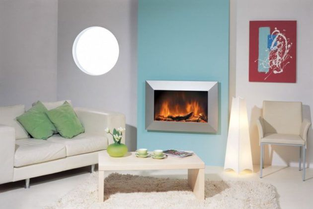 Камин с видео-изображением огня лучше всего вешать на стену